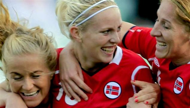 Cecilie Pedersen celebrates with her teammates after she scores Norway's first goal.